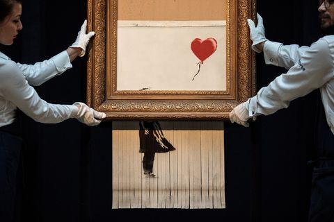 banksy shredded painting exhibition christies david hockney love is in the bin