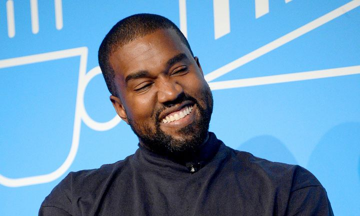 """Kanye West speaks on stage at the """"Kanye West and Steven Smith in Conversation with Mark Wilson"""""""