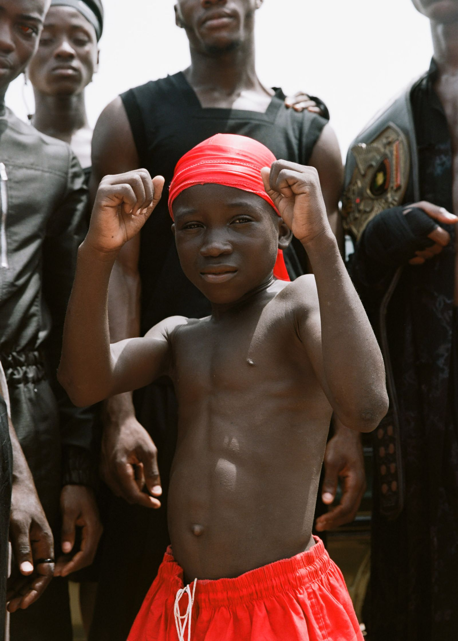 ROBERT TAGOE Jumpsuit RICK OWENS KID Shorts and durag STYLIST'S OWN PHILIP ESHUN Tank top and shorts BURBERRY