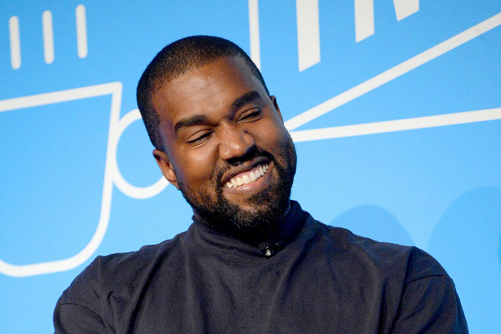 "Kanye West speaks on stage at the ""Kanye West and Steven Smith in Conversation with Mark Wilson"""