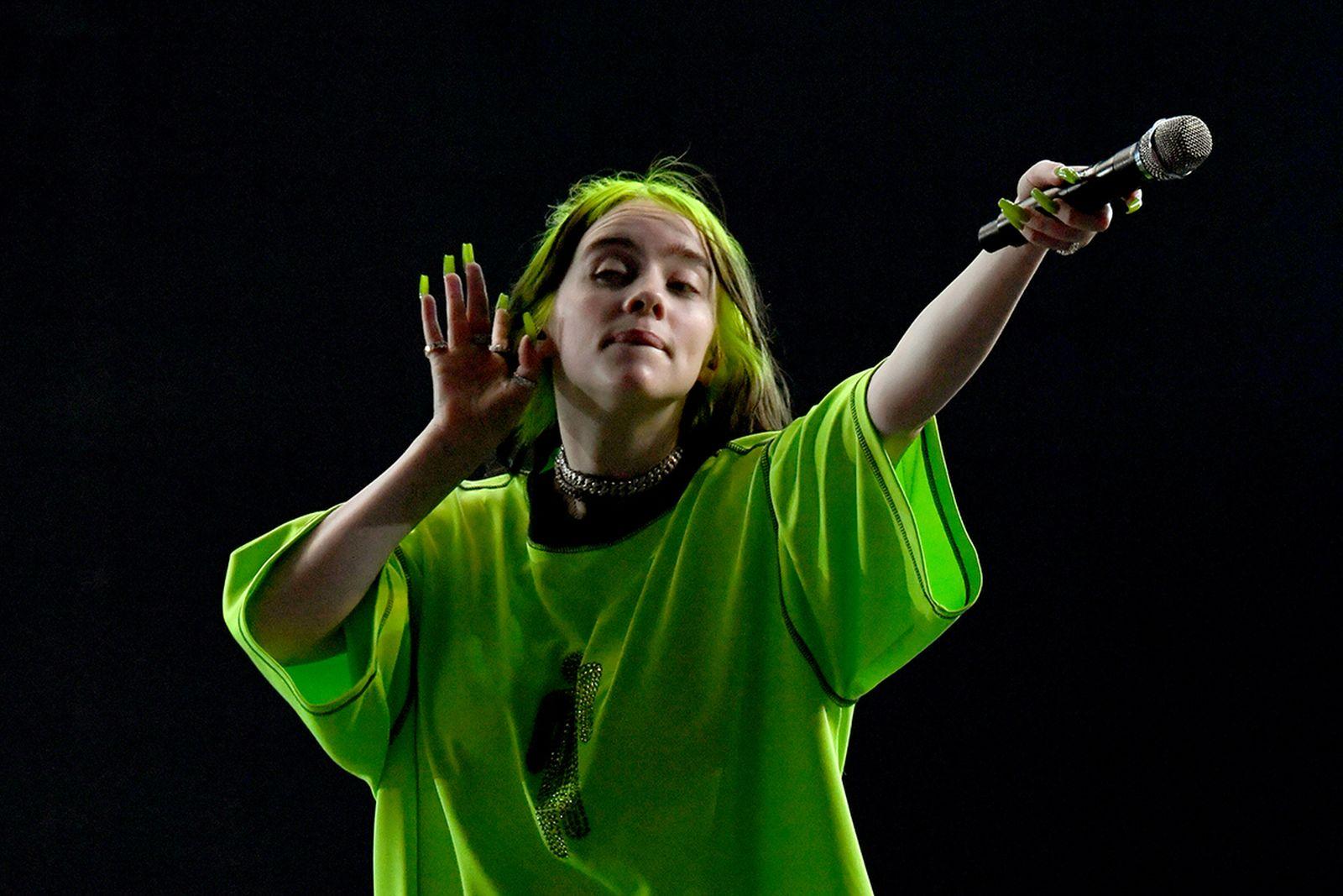 Billie Eilish performing green shirt
