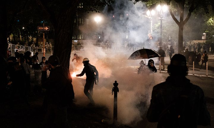 Federal officers use tear gas and other crowd dispersal munitions on protesters outside the Multnomah County Justice Cente