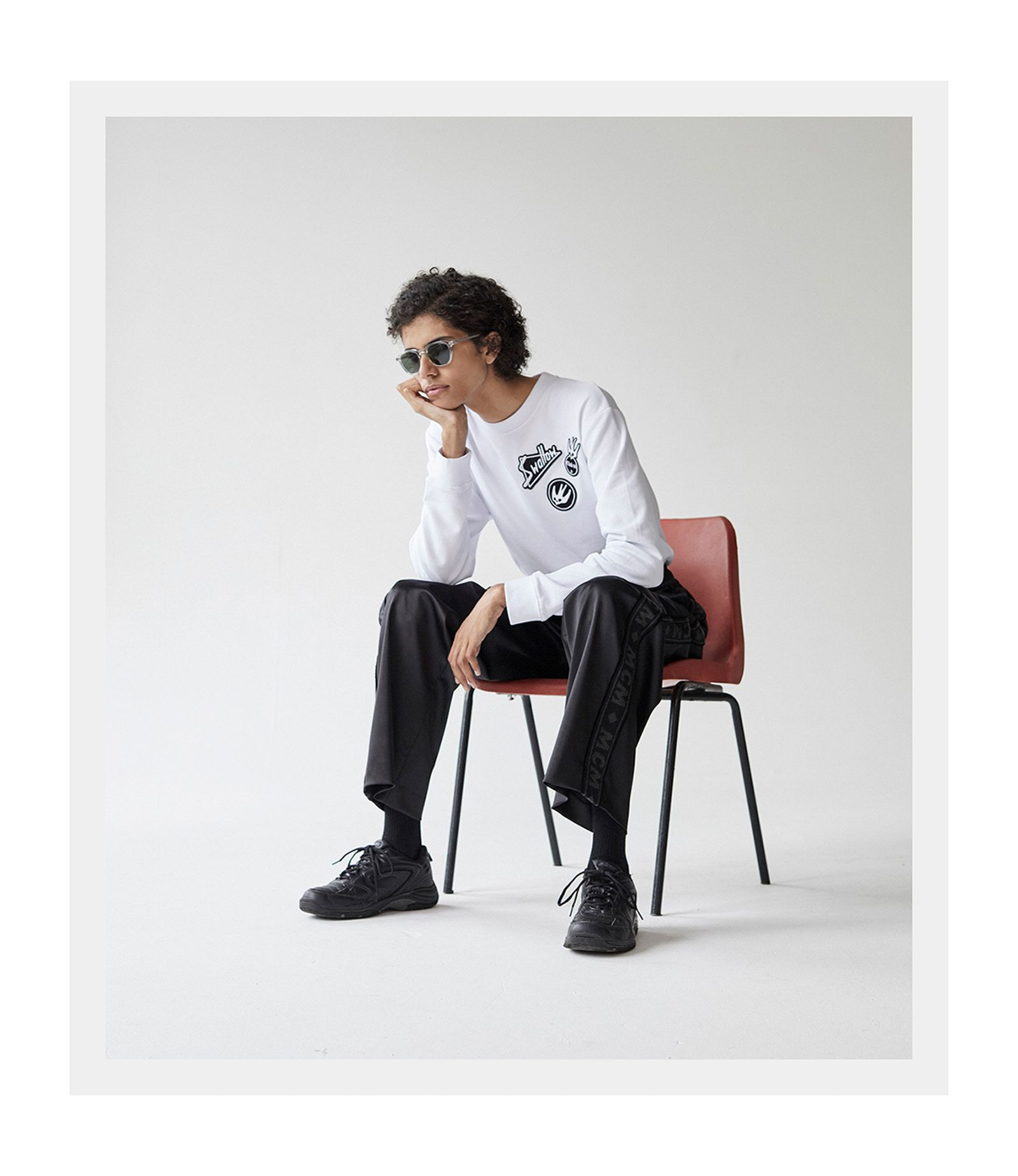 Sweater: McQ. Sweatpants: MCM. Sneakers. HI-TEC. Sunglasses: MOSCOT.