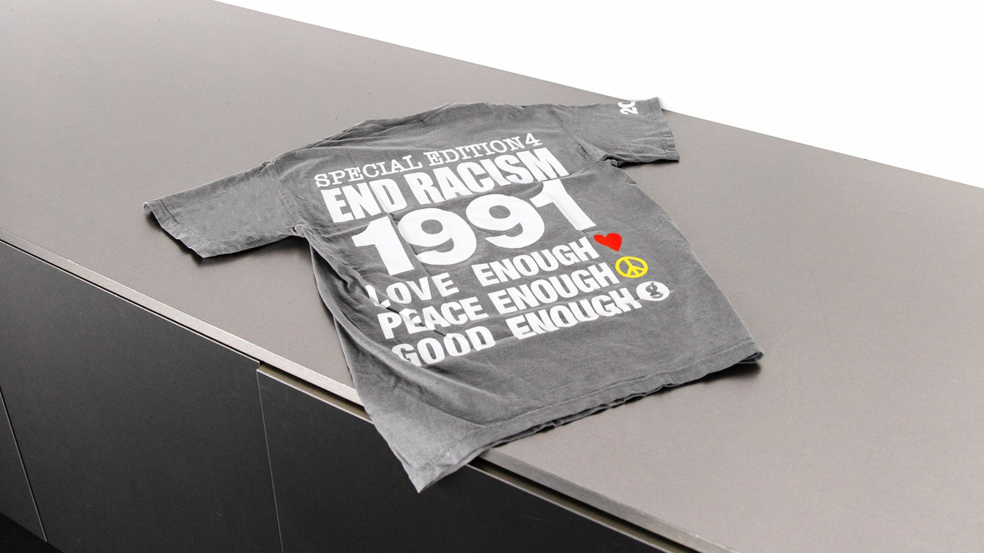INFINITE ARCHIVES - END RACISM TEE - carousel slide