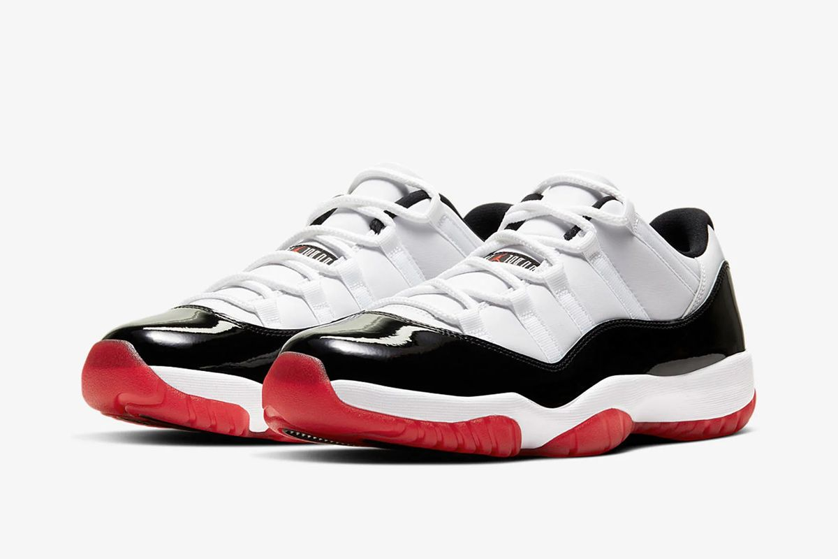 Product image of Nike Air Jordan 11 low in a black, white, and red colorway