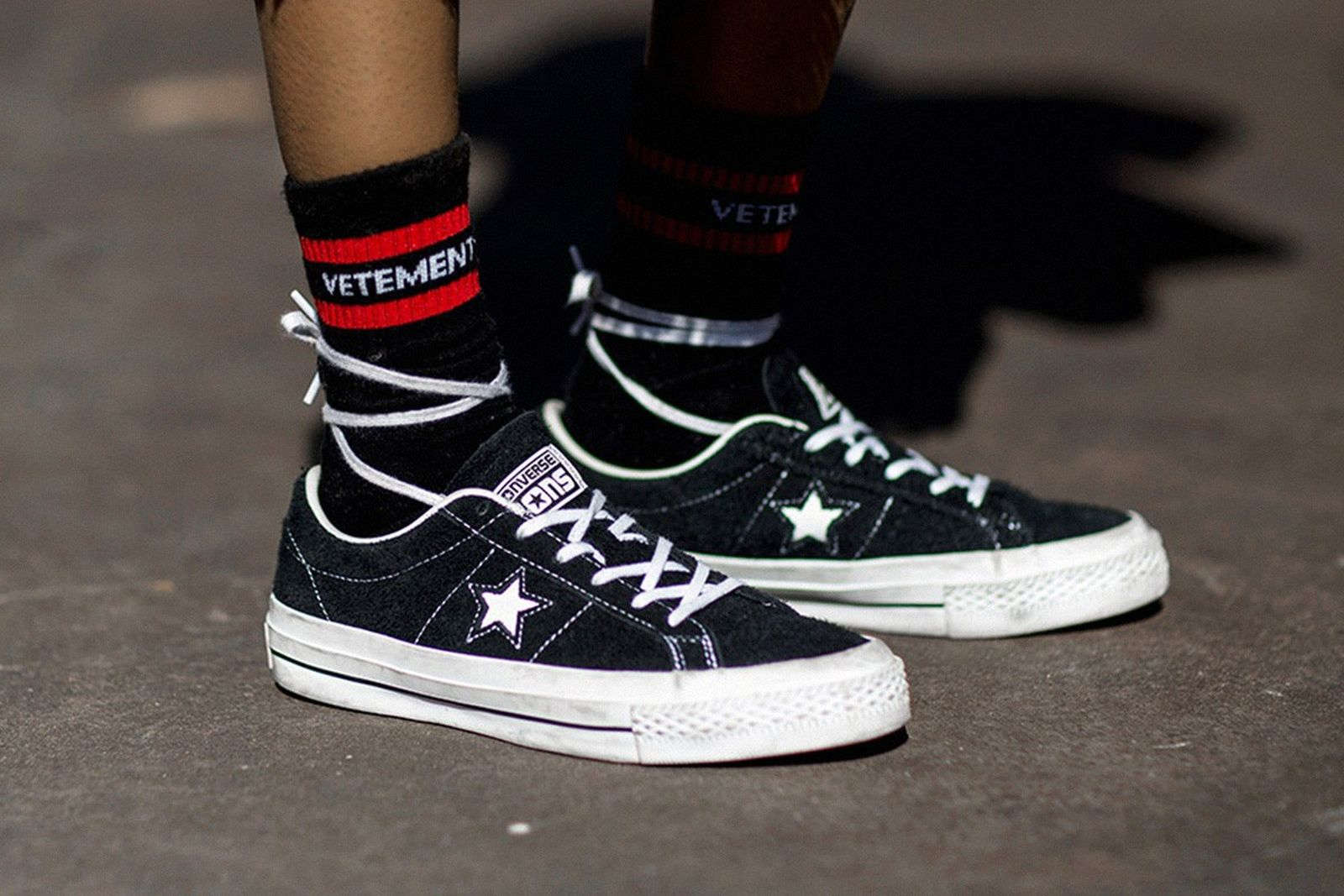 black and white Converse One Star on-foot side shot