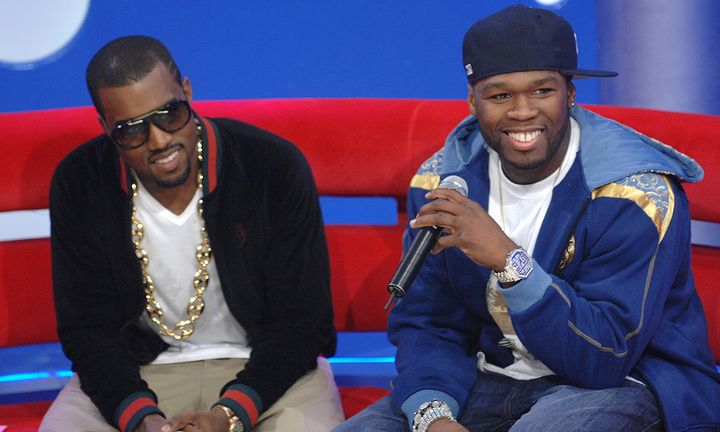 Kanye West (L) and 50 Cent appear on BET's 106 & Park at BET Studios