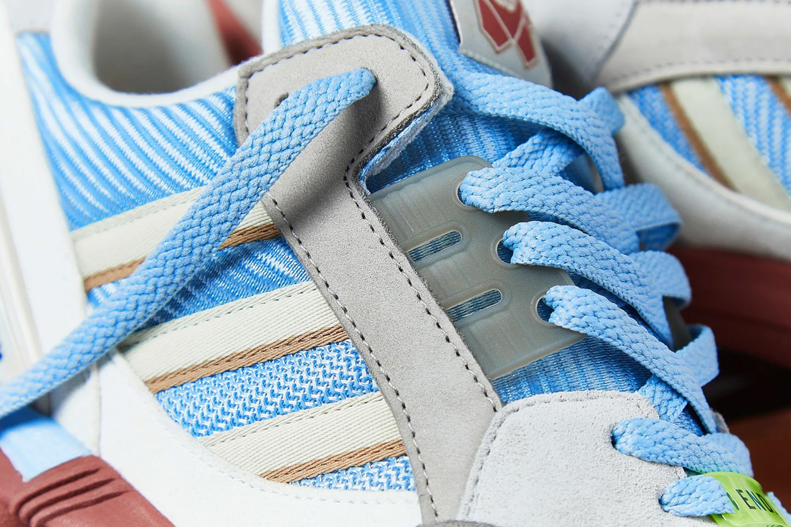 The END. x adidas Originals ZX 9000 collaborative sneaker in blue, grey, and terracotta colors.