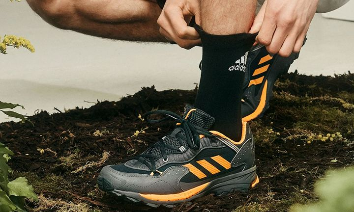 on-foot view of adidas Response Hoverturf in black and yellow