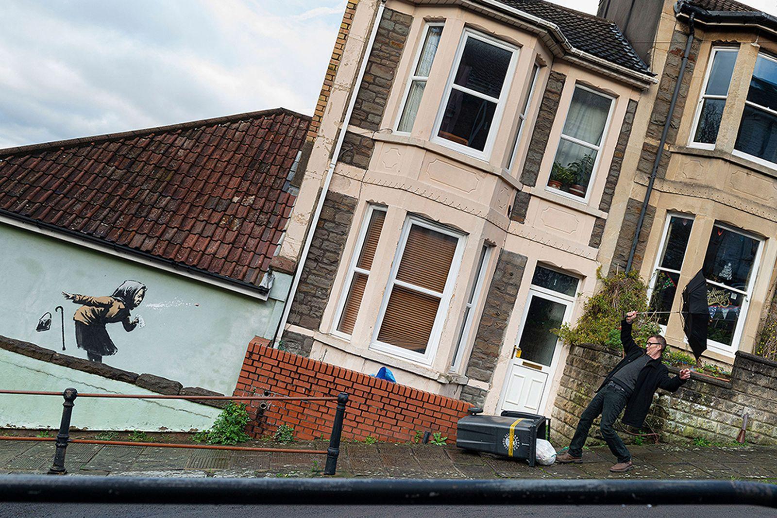 Banksy confirms he is behind sneezing woman artwork on Bristol house
