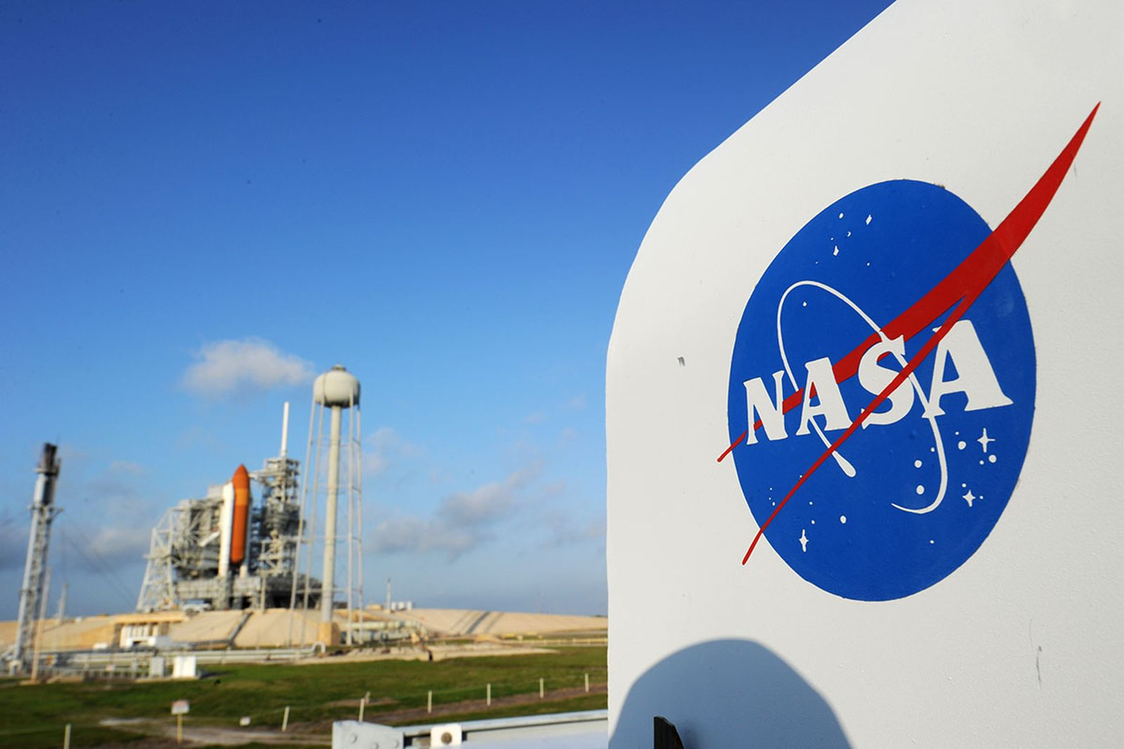 The NASA logo on a protective box for a camera near the space shuttle Endeavour