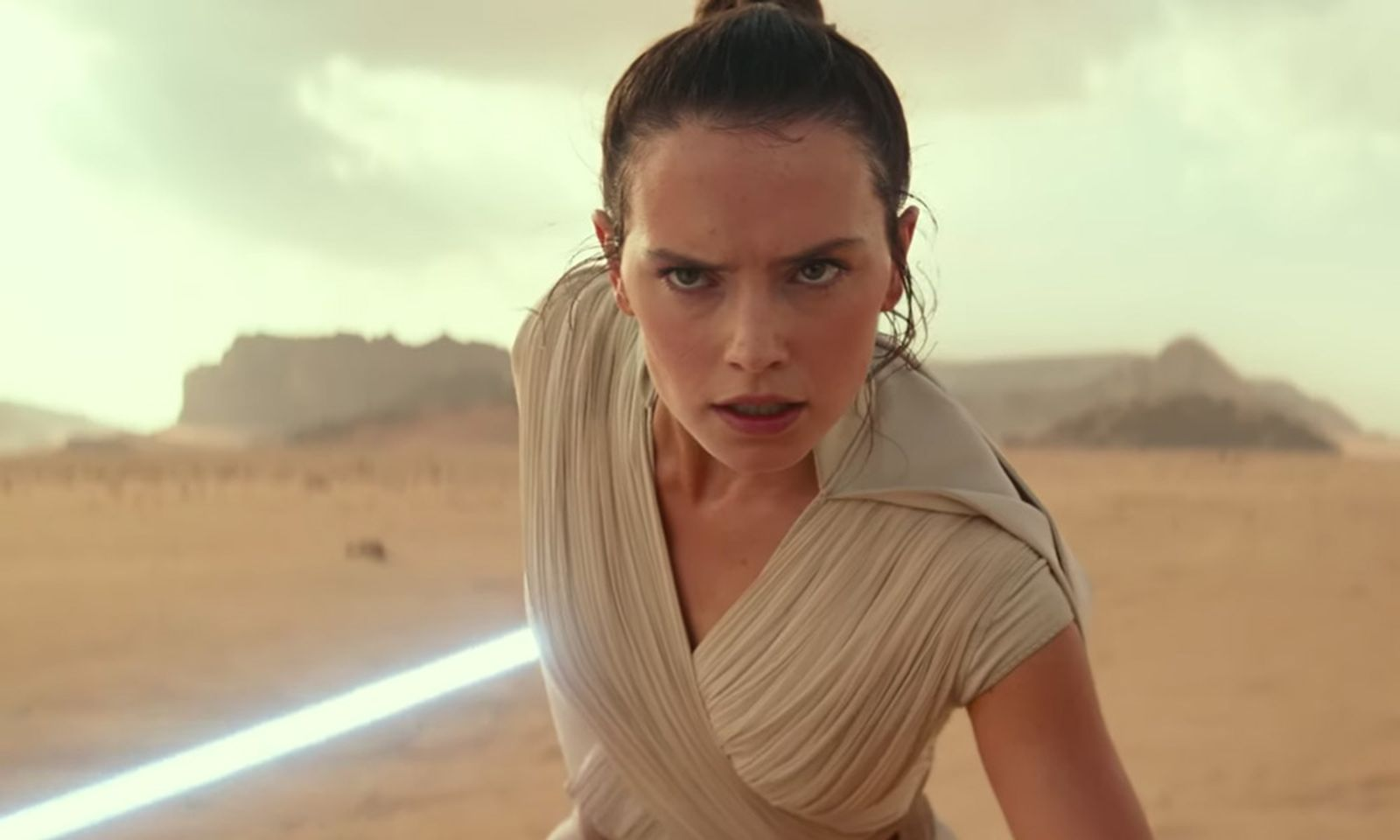 Star Wars: The Rise of Skywalker closeup in desert with lightsaber