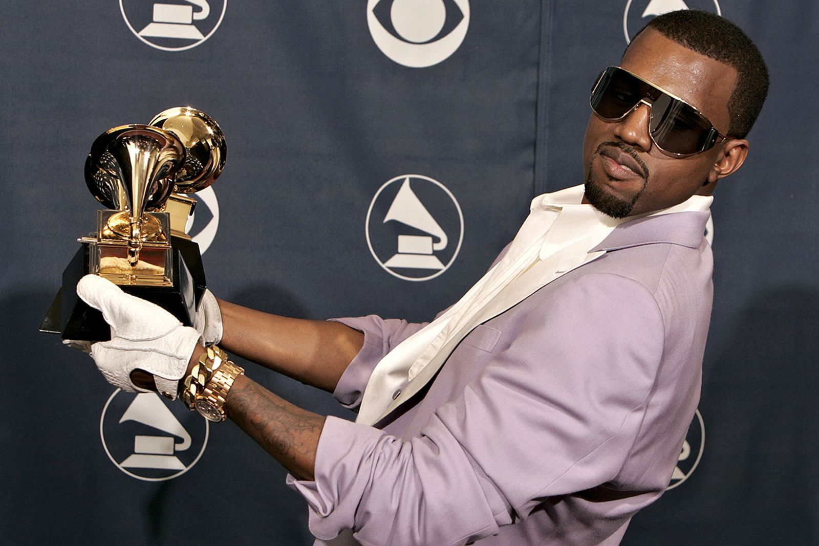 Kanye West with his awards at the 2006 Grammys