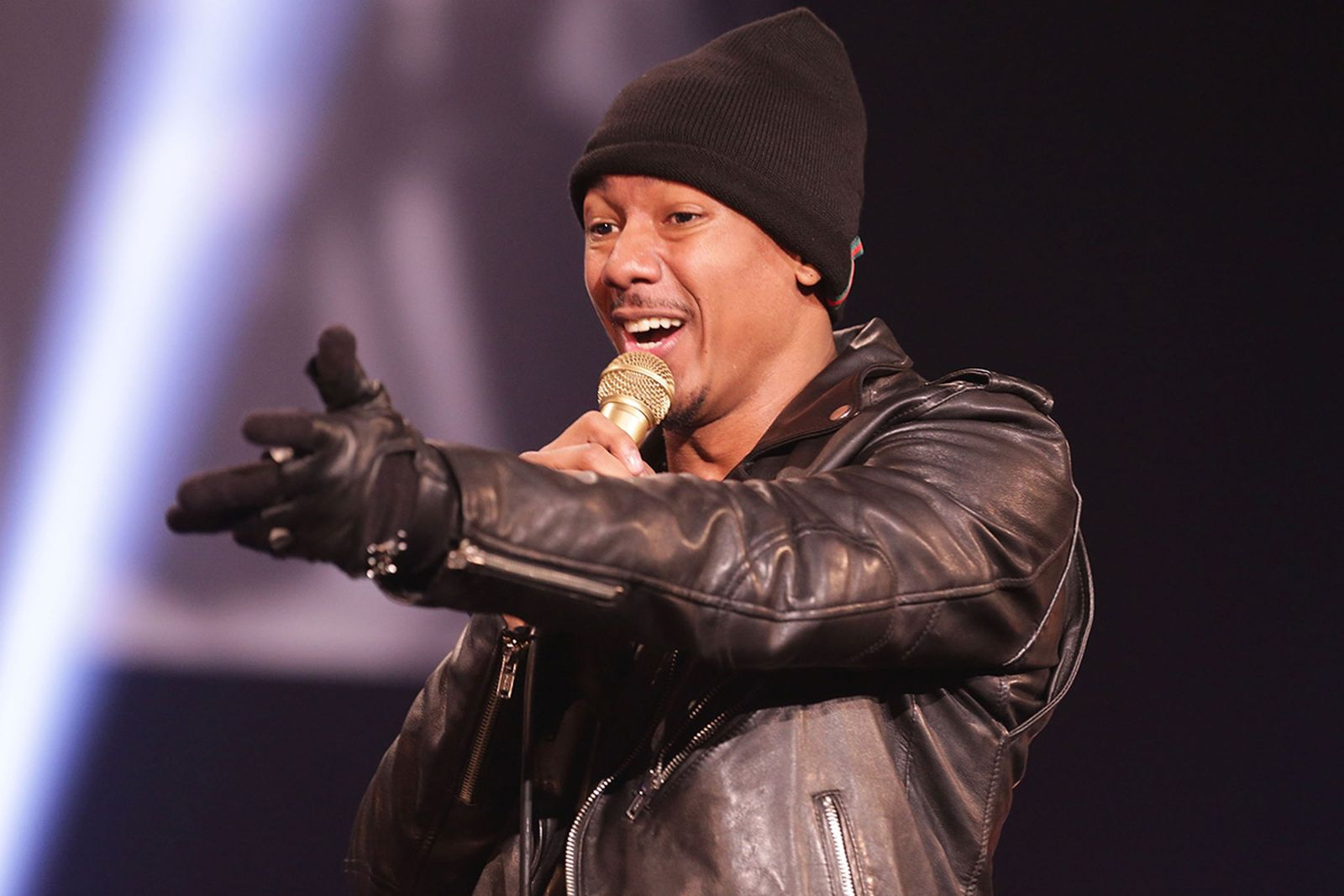 nick cannon performing on stage
