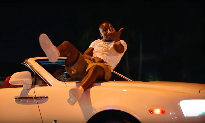 dababy middle finger up on a white car