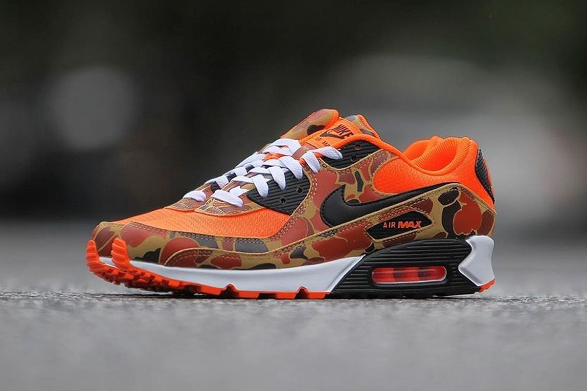 Side view of orange duck camo Nike Air Max 90