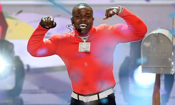 Dababy performs wearing red muscle shirt