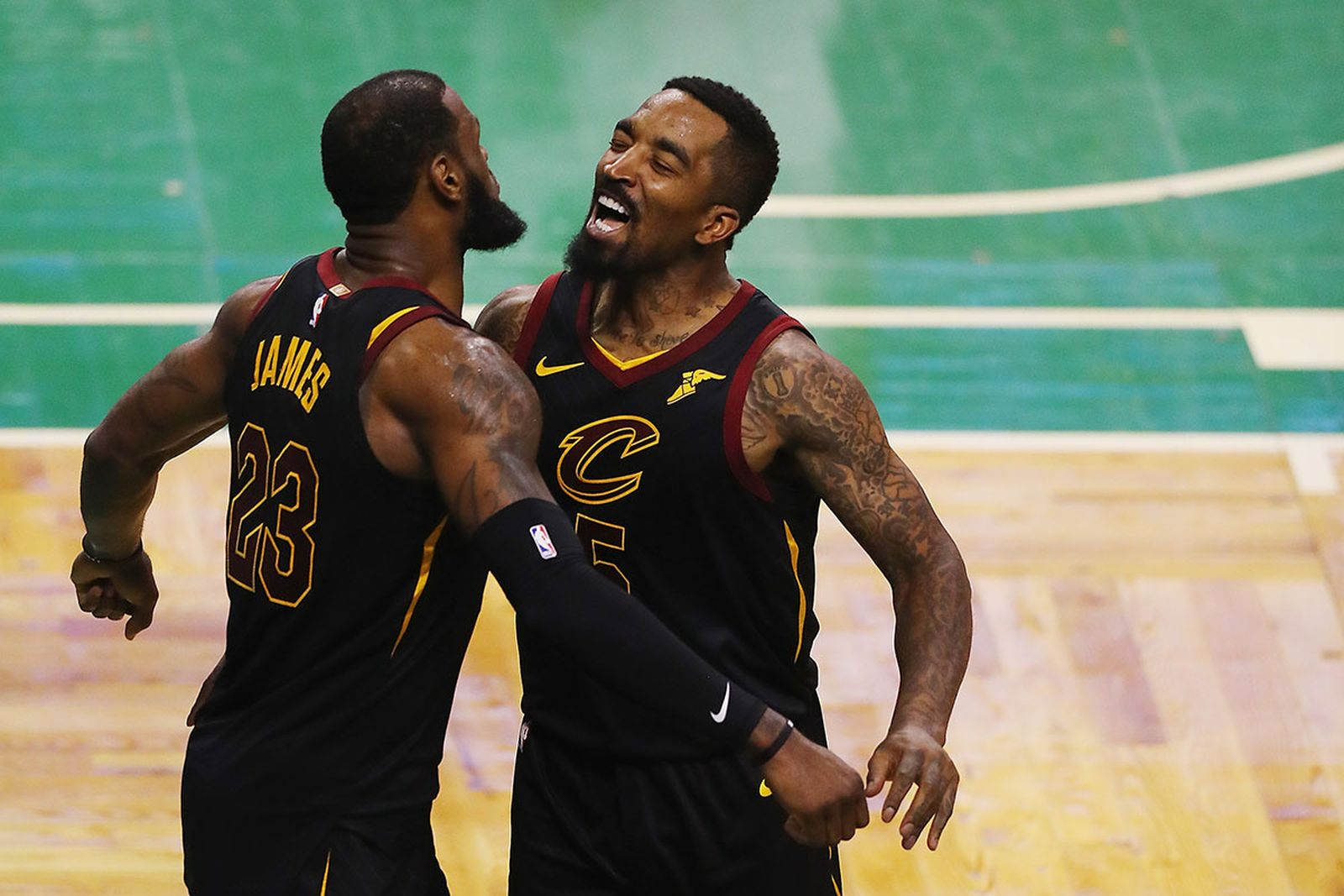 LeBron James #23 of the Cleveland Cavaliers celebrates with JR Smith #5 in the second half against the Boston Celtics during Game Seven of the 2018 NBA Eastern Conference Finals at TD Garden on May 27, 2018 in Boston
