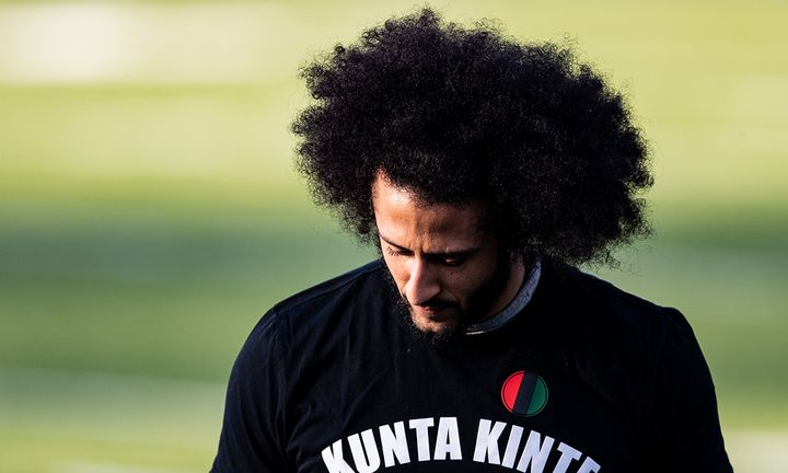Colin Kaepernick looks on during his NFL workout