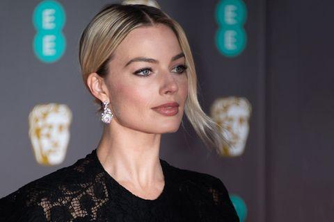 Margot Robbie attends the EE British Academy Film Awards