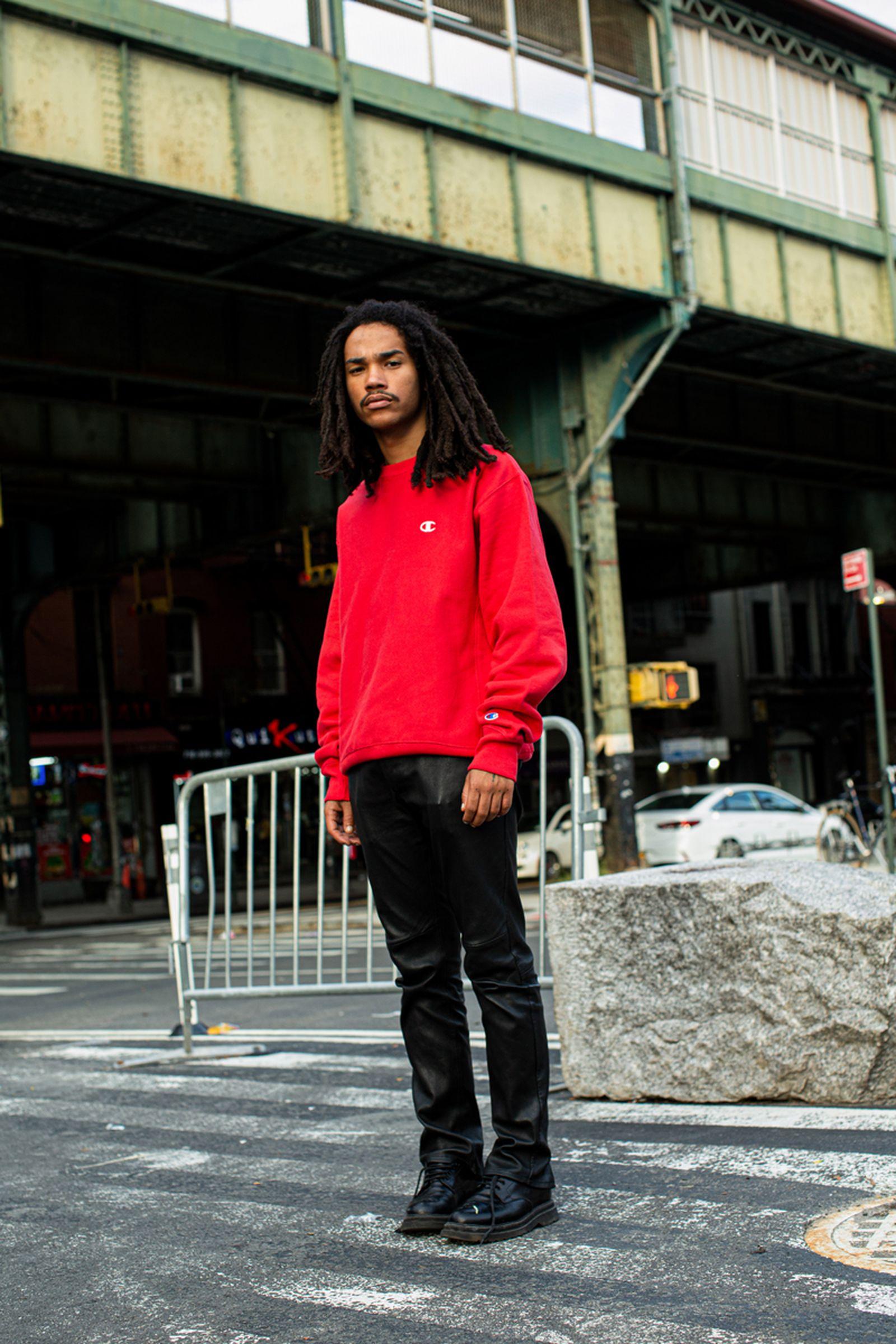 Luka Sabbat Portrait Hairstyle Red Sweater