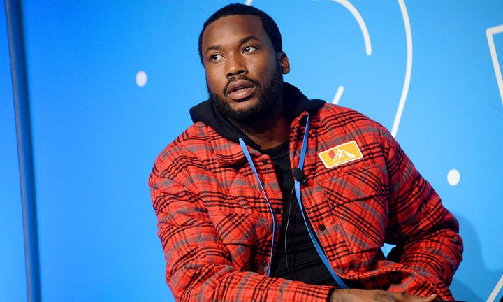 Meek Mill on stage blue background