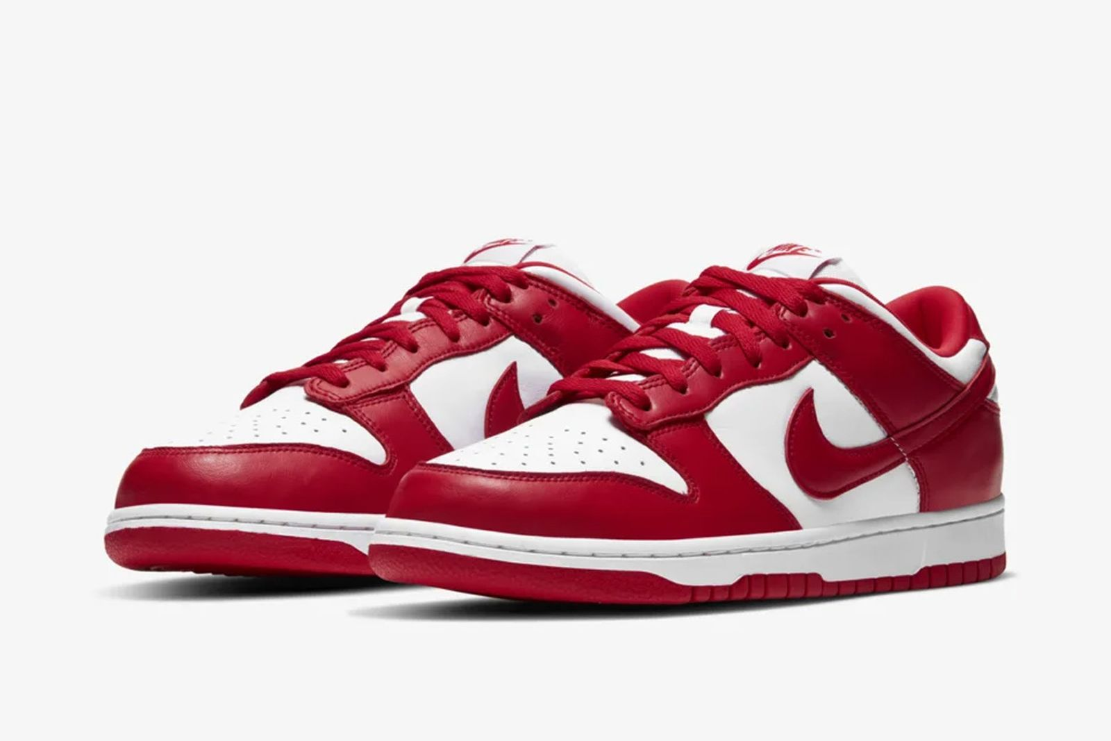 Red and white Nike Dunk Low side view both shoes