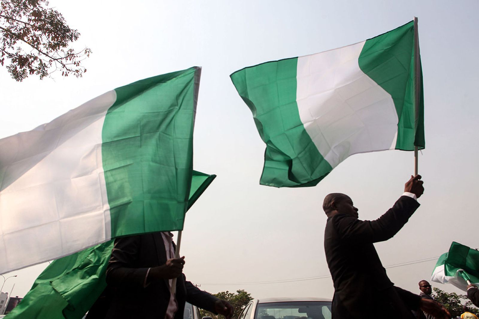 Nigerian lawyers hold up the national flag