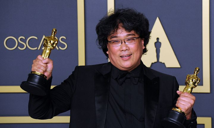 Bong Joon Ho poses with his Awards for Best Director and Best Picture