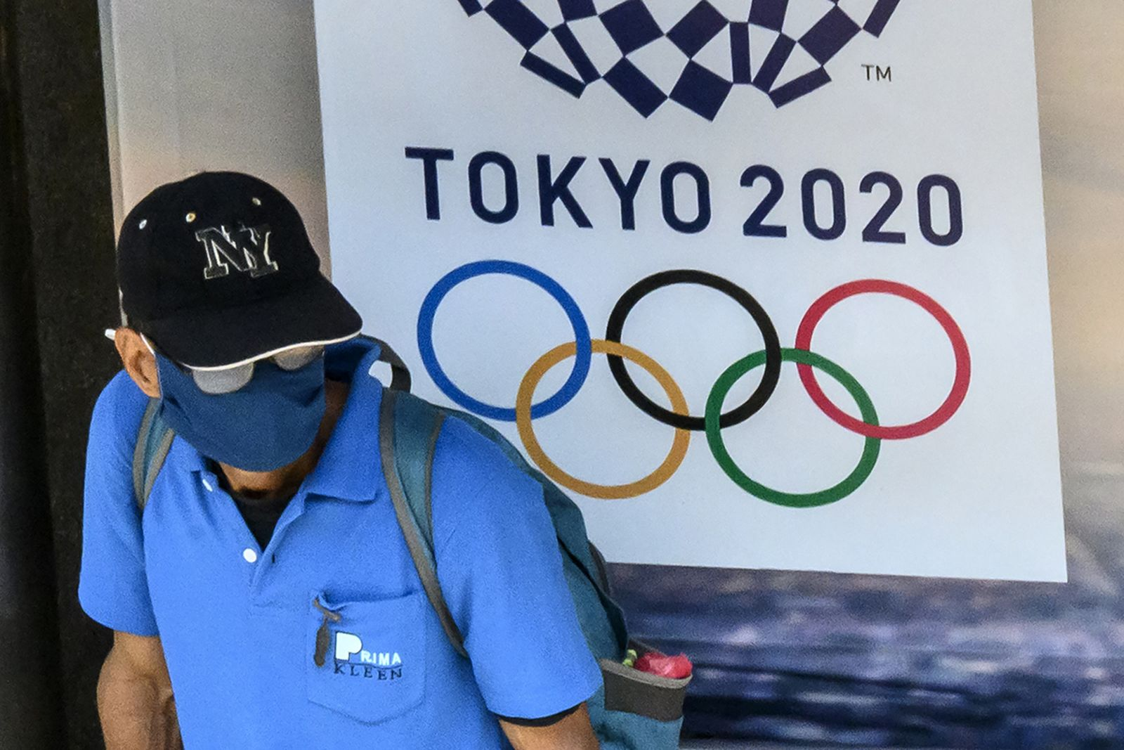 Tokyo 2020 Olympics sign man with mask