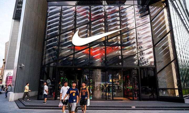 buyers leaving nike store with swoosh logo