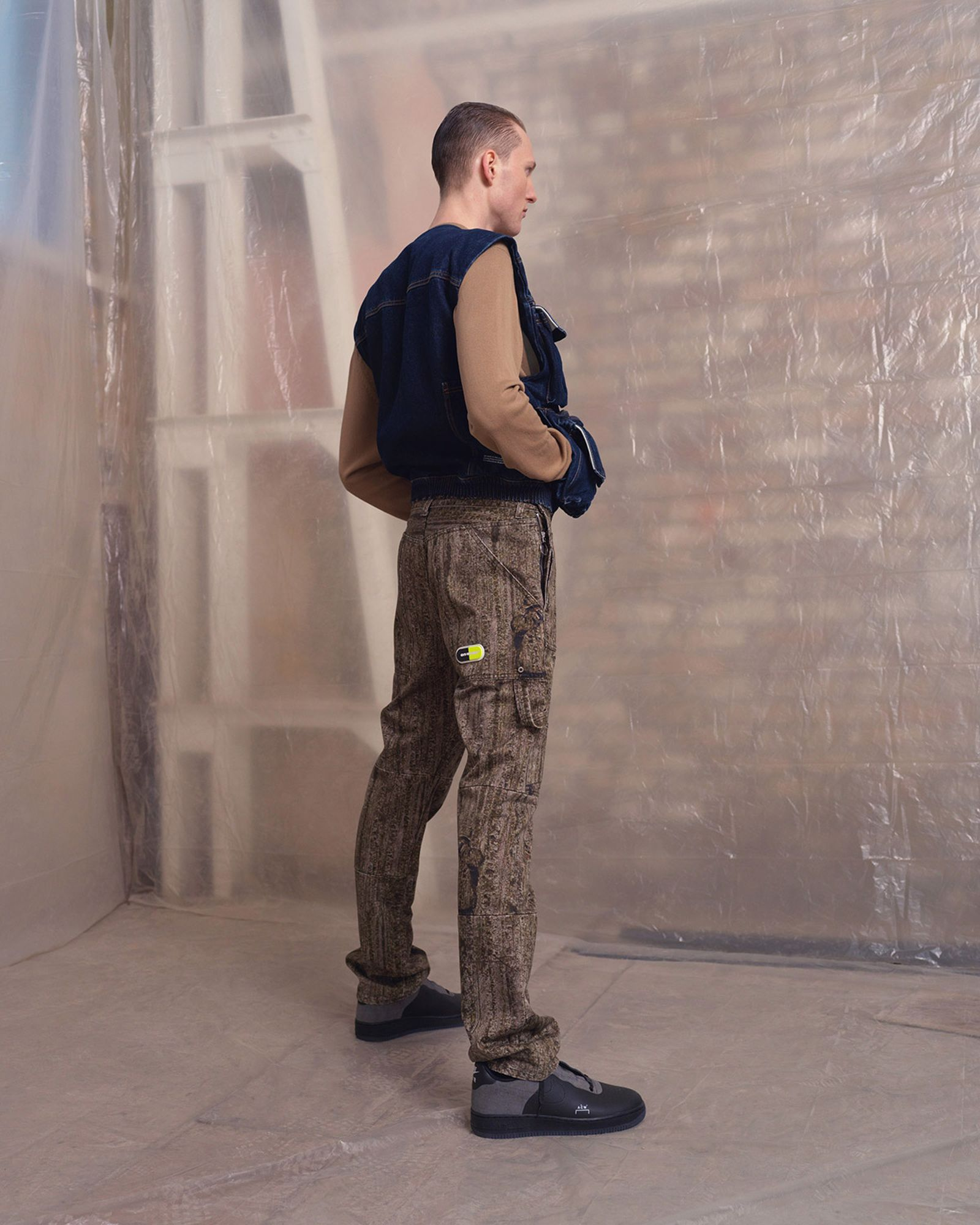 Model is wearing: Trousers and denim vest by OFF-WHITE, sweater by OAMC, shoes by Nike x A-COLD-WALL*