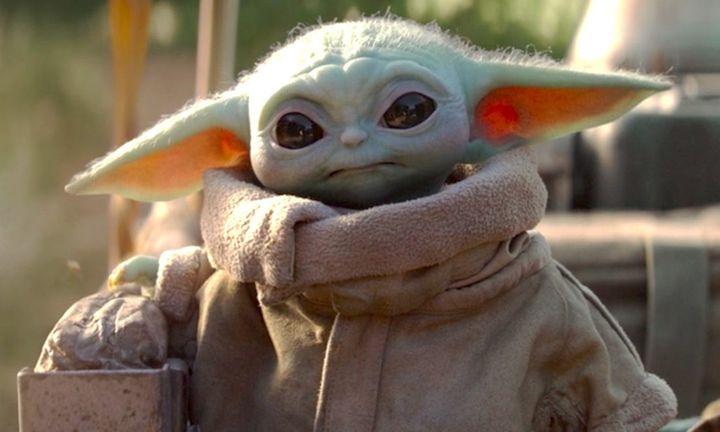 baby Yoda adorably holds a basket