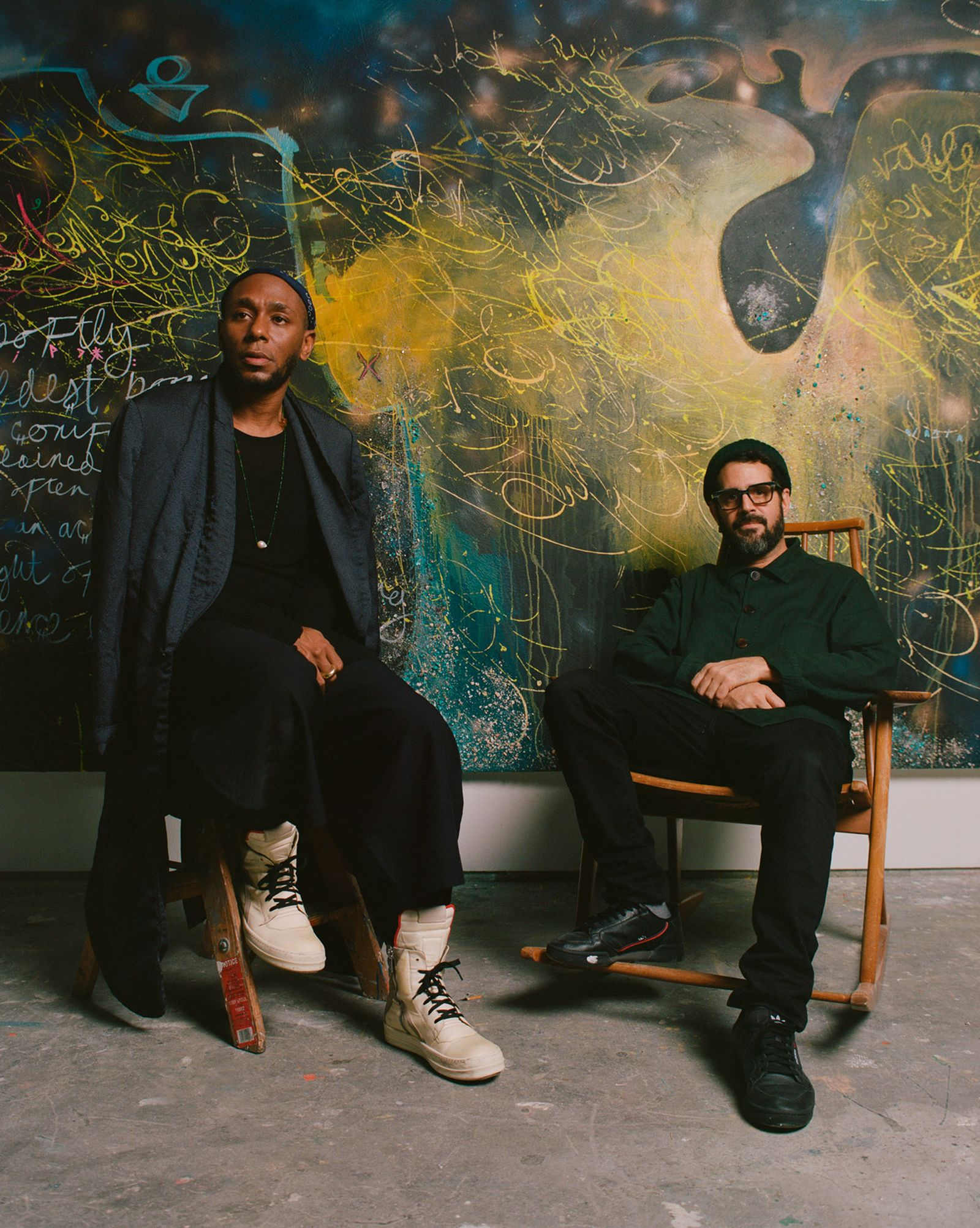 Yasiin Bey with Brooklyn-based artist José Parlá in front of their collaborative work, titled 'Sphere of influence. Constant cosmic contact. Bey. Negus,' at the Brooklyn Museum.