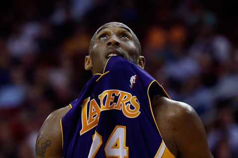 Kobe Bryant #24 of the Los Angeles Lakers looks up to the scoreboard