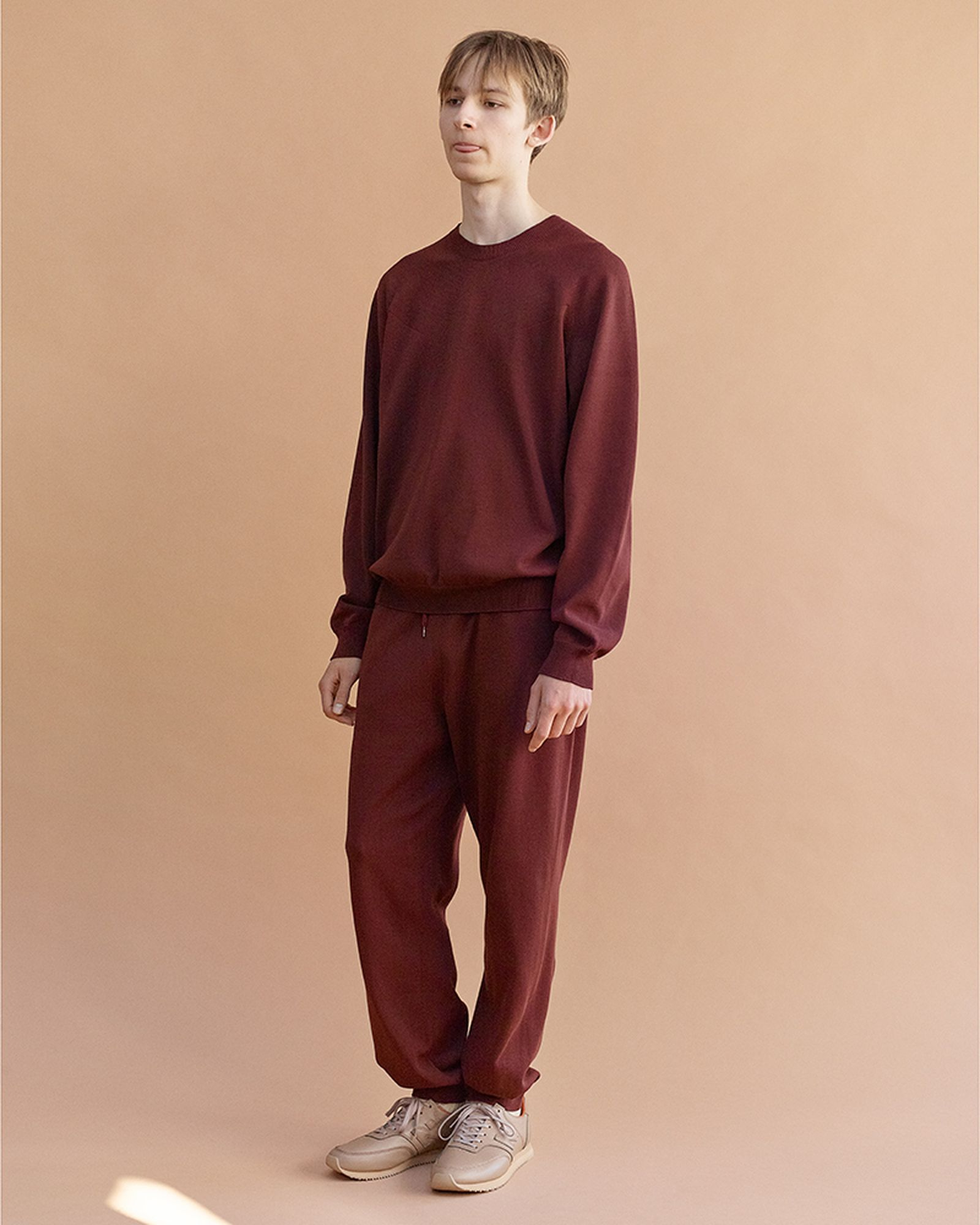 On model shot of a sweatshirt and sweatpants by Auralee