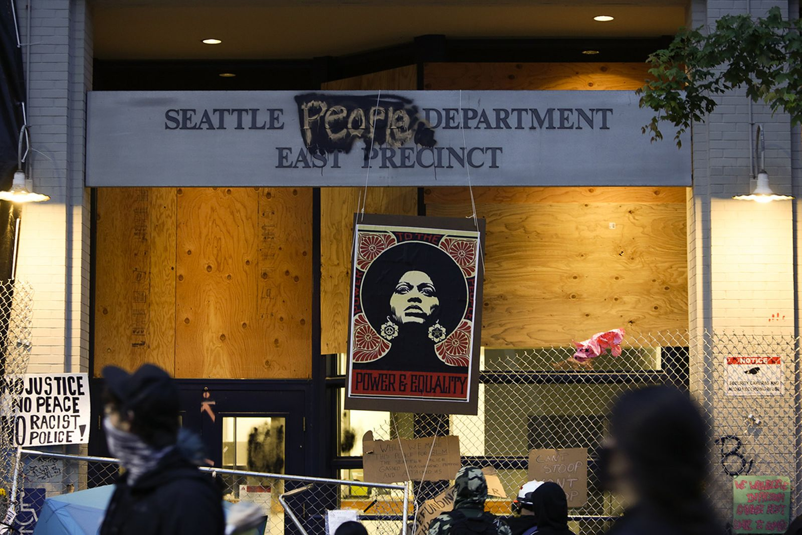 An image of activist Angela Davis is displayed above the entrance to the Seattle Police Department