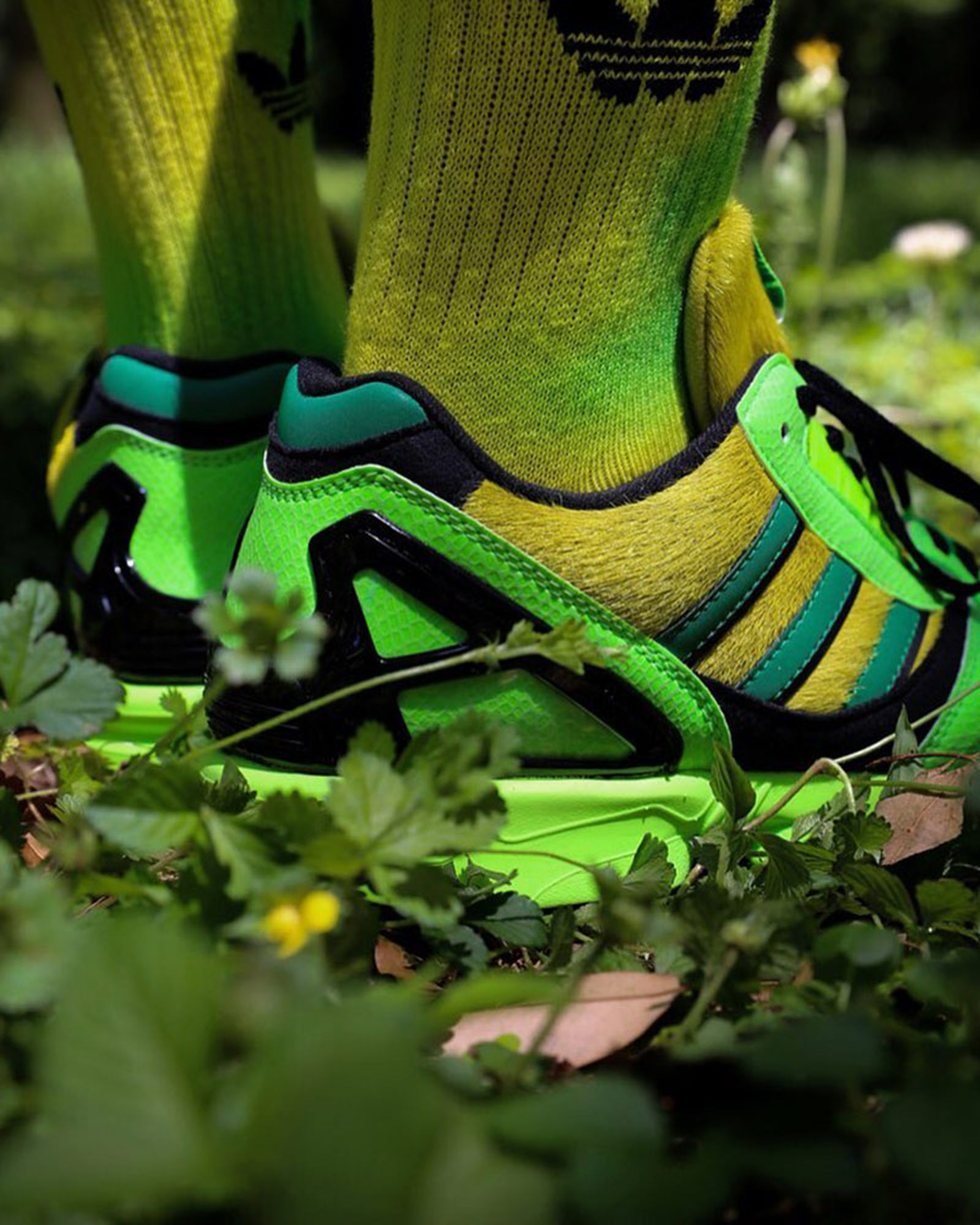 atmos x adidas ZX 8000 heel view yellow and green and black