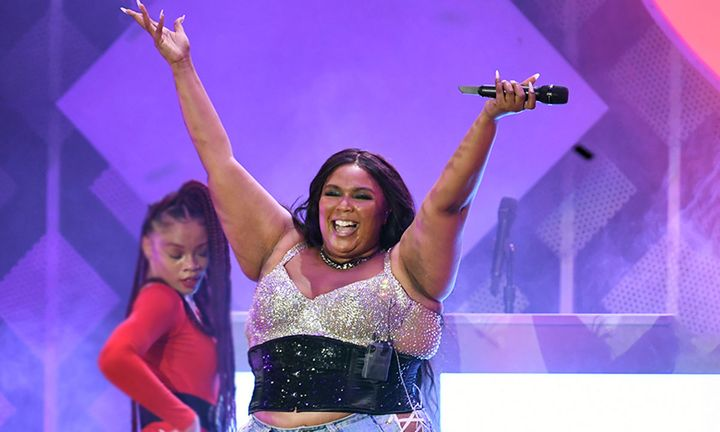 lizzo performs with dancer