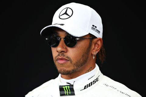 Lewis Hamilton of Great Britain and Mercedes GP poses for a photo in the Paddock