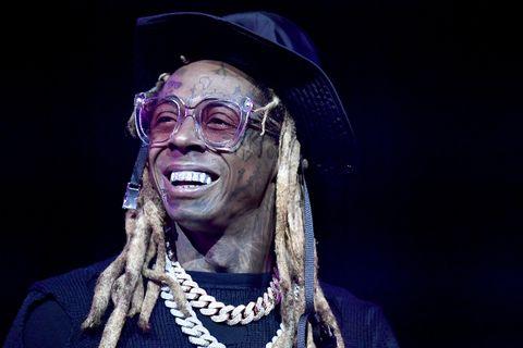 Lil Wayne glasses hat smiling