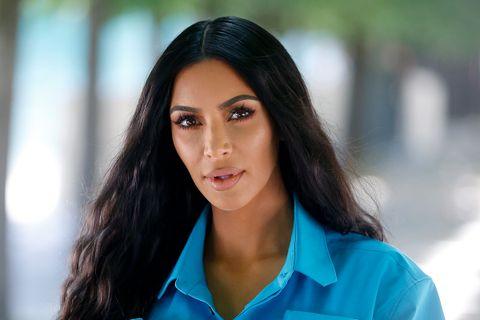 Kim Kardashian attends the Louis Vuitton Menswear Spring/Summer 2019 show