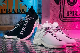 8d3a18f10fbb Prada Debuts New Knit Sneakers With Familiar Text Detailing