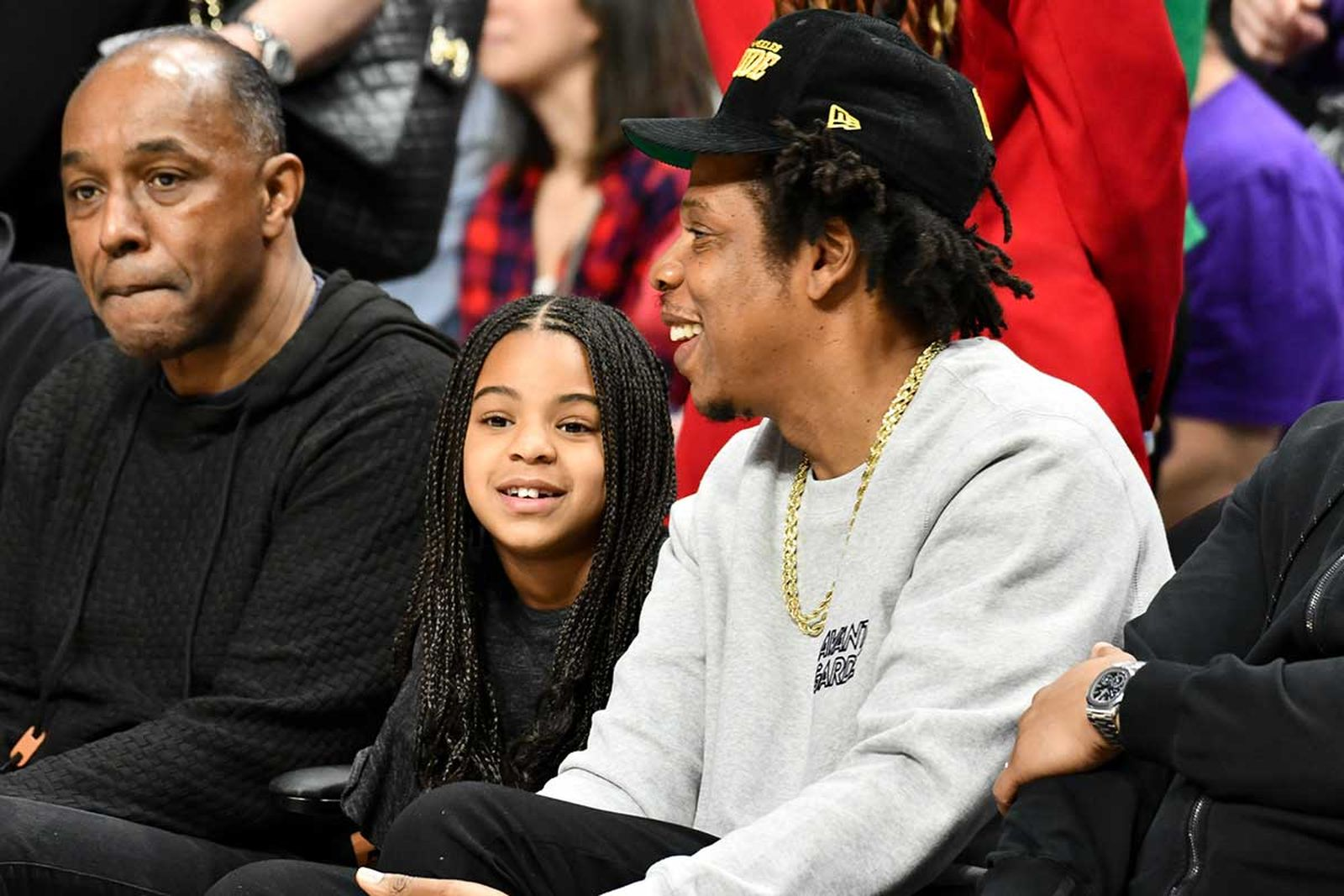 Jay-Z and Blue Ivy Carter attend a basketball game between the Los Angeles Clippers and the Los Angeles Lakers at Staples Center