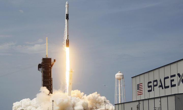 The SpaceX Falcon 9 rocket with the manned Crew Dragon spacecraft attached takes off from launch pad