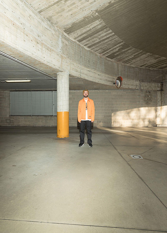 Gregorio Perrucci wears a Dickies jacket, Bape long sleeve t-shirt, Dickies pants and a Patta x Carhartt beanie.