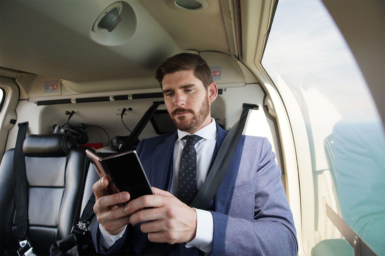 Luxury real estate agent Erik Conover multitasks on Samsung's Galaxy Z Fold2 5G.