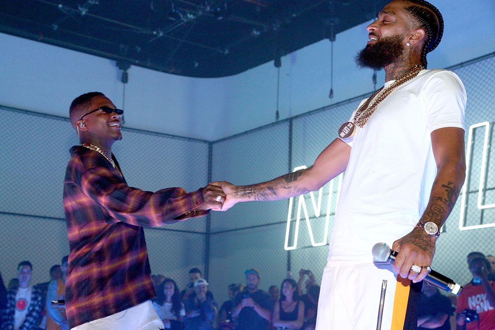 YG (L) and Nipsey Hussle perform
