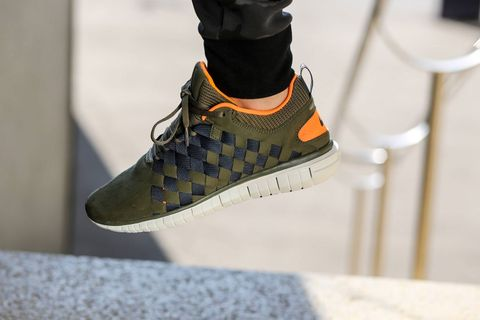 buy popular 4aced 410ed For the latest iteration of the Nike Free OG  14, Nike goes with an olive,  anthracite and orange color combination. The woven technique on the upper  ...