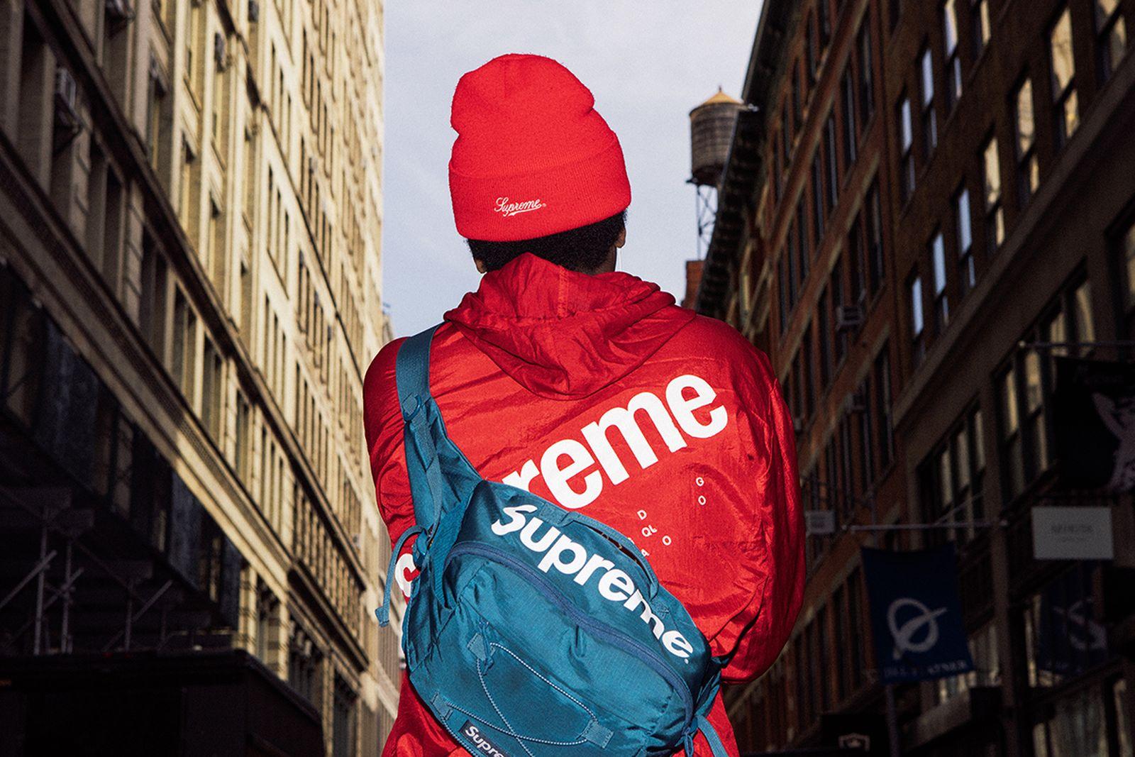Red Supreme hat and jacket, blue Supreme bag